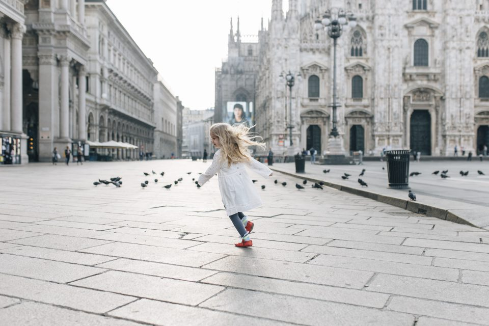Little girl running in Milan